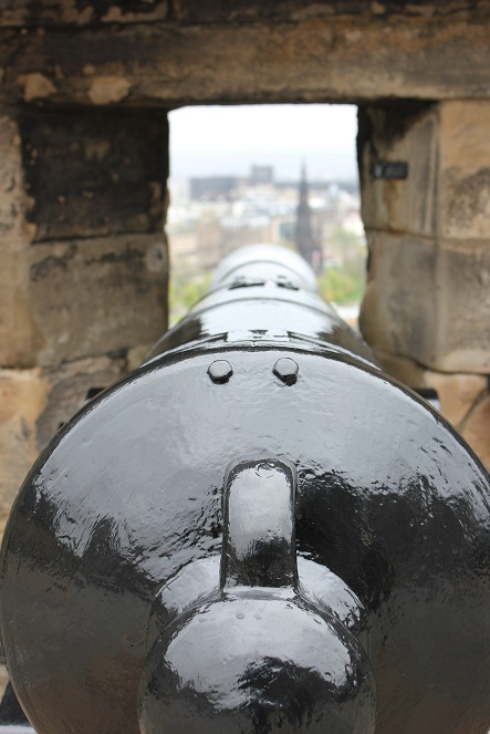 Looking over the barrel of a cannon at Edinburgh Castle in Scotland