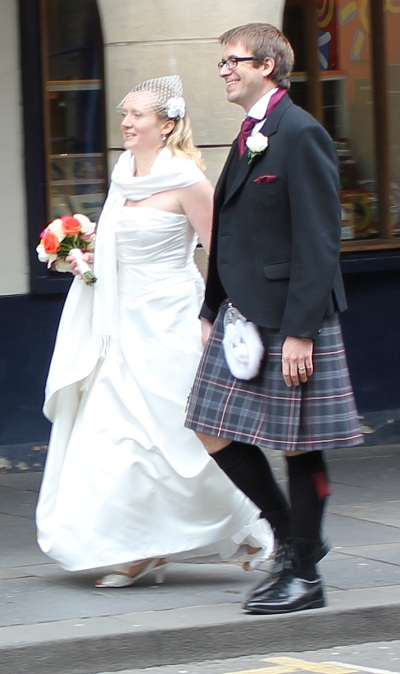 A wedding party in kilts on the Royal Mile in Edinburgh, Scotland