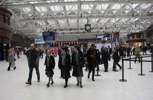 A group of Students arriving at the train station in Glasgow early in the morning